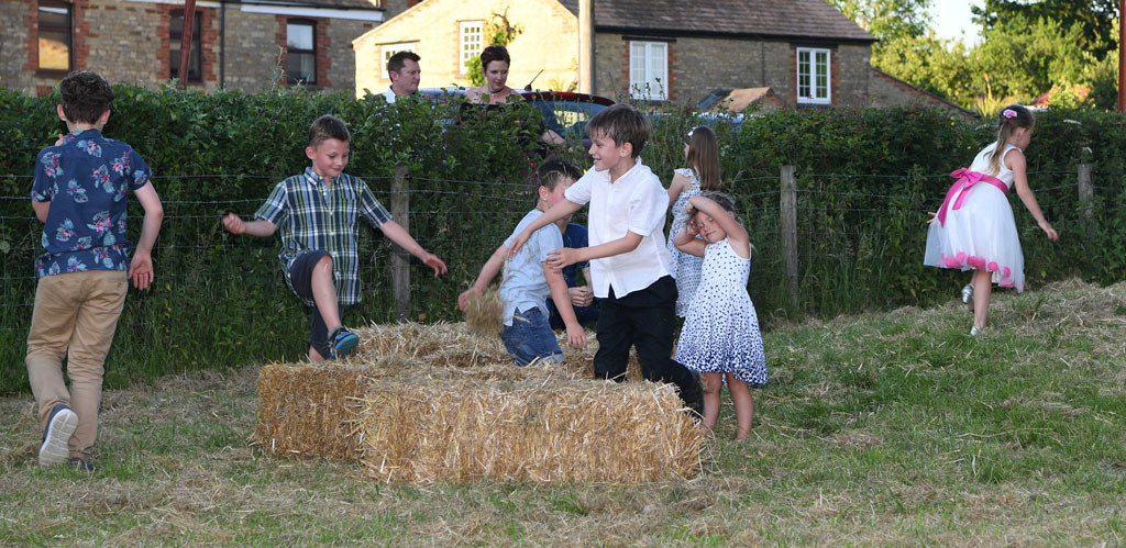 Children playing at a wedding
